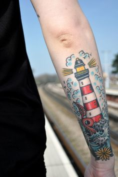 tattoo old school / traditional nautic ink - lighthouse with octopus