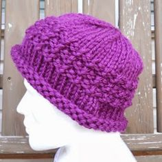 Free knit hat pattern: Pretty Purple Hat.  Whip up a hat in a matter of hours using this simple, bulky pattern.