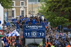 Chelsea players parade with Champions League trophy and FA Cup