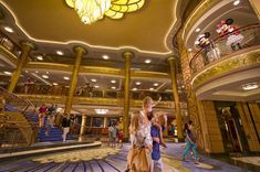 Disney Cruise Line's glamorous three-deck atrium lobby on the Disney Fantasy showcases classic Art Nouveau Style reminiscent of grand ocean liners of the Golden Age with touches of Disney magic