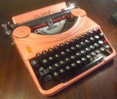 The Oliver Portable - The wingless Oliver has a key-feel not too unlike the early Noiseless portables. Shown above in a wild salmon finish. Photo courtesy of Robert Messenger, OZ Typewriter Blog.
