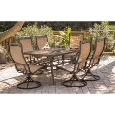 Hanover Monaco Tan Aluminum 7 Piece Dining Set With Six Swivel Rockers And A 68 X 40 Inch Table Size Sets Patio Furniture