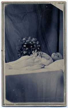 Infant Post Mortem Photography: via Flickr. Photographs were frequently taken of loved ones, and then displayed in family photographs. The Victorians had a completely different attitude toward death than we have in modern times.