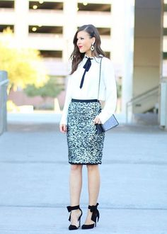 Brie of Sophistifunk is looking chic in our black and white bowtie blouse. She keeps the outfit festive with a sequin pencil skirt and black heels with bow tie detail   Banana Republic