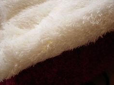 Acrylic -can imitate animal fur or fleece -lightweight  -soft hand -warm -easy to wash -breathable