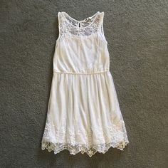 H&M Cream Lace Overlay Dress sleeveless 11-12 Simple yet stunning dress from H&M. Girls size 11-12 years. It has an attached under slip. Excellent condition with no stains. H&M Dresses Midi