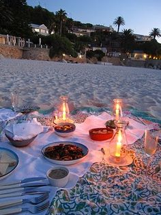 beach style picnic HOW ROMANTIC! I like how the candles are in something so they won't tip and light your blanket on fire.