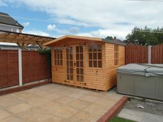 Quality wooden summerhouse with large canopy