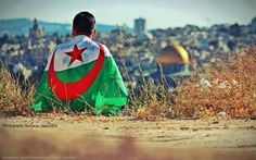Palestinian with the Algerian flag or Algerian in Palestine. lol ;)