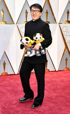 Jackie Chan from Oscars 2017: Best Dressed Men  Beyond the stuffed animals is an expertly-tailored ensemble complete withsome really cool dress shoes.