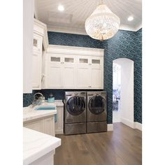 Caitlin Wilson Design | This laundry room would easily put doing laundry at the top of my list.