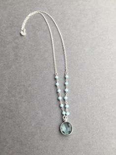 """Dainty Blue Topaz Pendant paired with Chalcedony beads on a rosary style chain. This lovely hangs at 17"""" with all metal components in sterling silver. Blue Topaz is another birthstone for December.($41) #Decemberbirthstone #gemstonejewelry #bluetopaznecklace"""