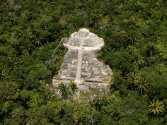 "Belize's Lamanai Mayan ruins are surrounded by the jungle's thick vegetation. And in case you didn't know, the word Lamanai comes from the Maya term ""submerged crocodile"" -- a nod to the reptiles that live along the banks of the New River."