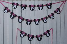 Cricut powered project. We used the Minnie Mouse silhouettes and ribbon to string the banner together.