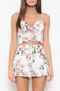 The floral two-piece every girl needs. Lace-up top with lightly padded bust and ruffle hem. Adjustable straps. Cute high-waisted short with ruffle hem. 100% Rayon