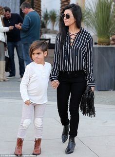 Out and about: Kourtney was seen with five-year-old Mason during a shopping trip in Beverly Hills on Friday