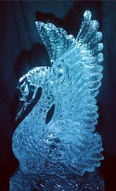 Swan ice sculpture. Swans mate for life. I want two of these at my weddding!