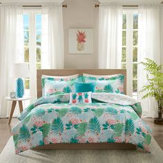 Awake in paradise with the Intelligent Design Tropicana Comforter Set. Featuring a refreshing color palette of blue, green, and coral, the comforter showcases oversized tropical plants that mimic the appearance of a lush, exotic jungle. The reverse flaunts a delectable pineapple pattern, enhancing the tropical aesthetic. 2 decorative pillows reiterate the color scheme and tropical motif to add the finishing touches to this comforter set.
