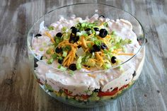Recipe for Tex Mex Layered Salad made vegetarian and gluten-free, but easily adaptable to add chicken or beef. Photographs included.