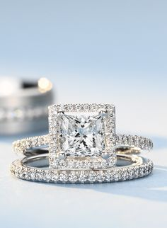 Beautifully designed, this engagement ring showcases a halo of micropavé-set diamonds to frame the princess cut diamond of your choice.