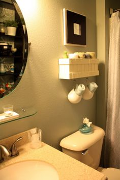 @A parade of homes - I love the towel rack, its a great way to store fresh towels for guests and family, especially if you have a small bathroom.
