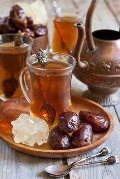 Traditional Arabic tea with dry medjool dates and rock sugar nabot
