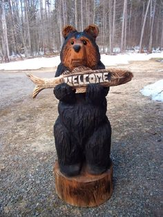 """42"""" Chainsaw Carved Black Bear Holding Fish Welcome Sign by carvnstitch on Etsy https://www.etsy.com/listing/182055284/42-chainsaw-carved-black-bear-holding"""