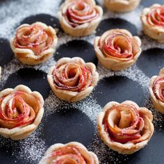 Dust mini rose apple pies with powdered sugar