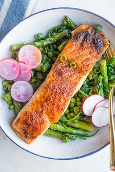 Crispy Salmon Bowls with sauteed asparagus, peas, onions and garlic make for an amazingly flavorful, vibrant and fresh healthy meal. Paleo, whole30, and keto! Made in under 30 minutes. #paleo #whole30 #keto #lowcarb #dinnerrecipe #fish #salmon