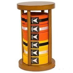 "Round Stacker Karate Belt Display - 6 Level by BP. $34.99. The Stacker Belt Displays have a solid wood base and top with a semi gloss finish. The unique round design will hold your rank belts in place without any attachments. Some assembly required. Belts not included. Measures 8"" D x 14"" T."