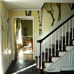 Your entry hallway walls have been stripped of wall paper....what are you going to do? Consider a hand painted decorative wall treatment.