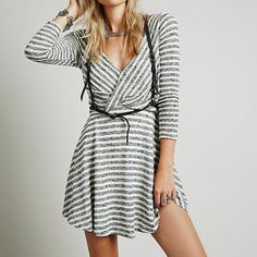 ✨SALE✨HOST PICKFree People Maverick NWT•Never Worn Marled stripes lend eye-catching dimension to a flirty dress that features a plunging surplice neckline in front and back and a playful A-line skirt. - 62% polyester, 38% cotton - Machine wash cold, tumble dry low NO TRADES • Price Is Firm Free People Dresses Mini