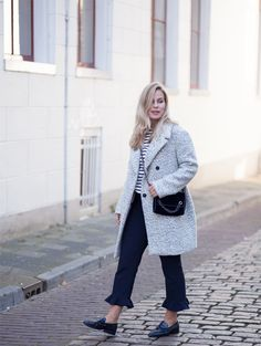 How to make your basic outfit less basic | Style by Jules. Black and white striped sweater+navyruffle hem trousers+black loafers+grey oversized coat+navy velvet chain shoulder bag. Fall Outfit 2016
