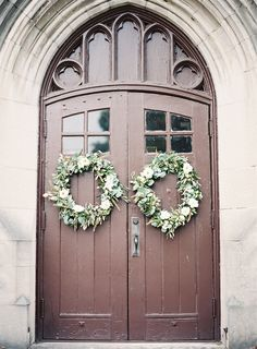 wreaths for front doors of church with flowers to coordinate with bouquets
