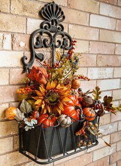 Beautiful Fall arrangement in ornamental black hanging wall container    http://tracys-trinkets-treasures.blogspot.com/