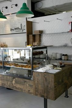 Love the diagonal subway tile.. & natural wood textures with pop of kelly green. Ou Meul Bakery | Cape Town