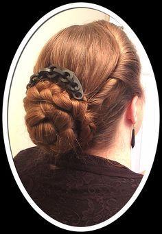 The lady's antique 1840-1860's vulcanite mourning chain hinged hair comb. Beautiful twisted hair wrapped around braided bun.