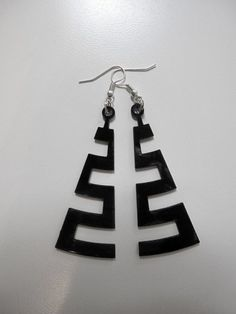 cut the groove - coarse - vinyl laser cut earrings | CreativeUseofTechnology - Jewelry on ArtFire another get use for our old LP's !