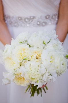 A variety of cream and white flowers with little/no foliage accents, for the bride.