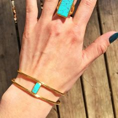 Julie Vos Gold and Turquoise Double Sided Bangle 24 karat gold plated stacked bangle has two small rectangular turquoise stones on either side. Looks amazing alone or stacked with a bunch of other bangles. Super cute! Julie Vos Jewelry Bracelets