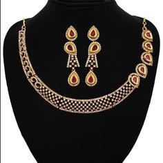 RUBY WITH CZ NECKLACE SET  http://www.sthrielite.in/collections/necklace/products/ruby-with-cz-necklace-set-22