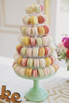 #Macaron Tower - Yum! Forever Photography Studio   See the wedding on SMP - http://www.StyleMePretty.com/2014/01/06/colorful-chateau-cocomar-wedding/