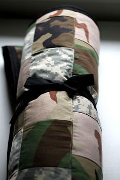"""""""Quilt made from military BDU's."""" So cool! This is a great service idea & would be an fun way to get children learning how to sew & teach them to help others. You could use patriotic fabrics too when they come out on pre-sale in a couple of months before summer. My younger siblings did this for the VA hospital."""