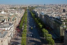 Champs-Élysées - Featured on RueBaRue.   This palatial tree-lined avenue is the site of many of Paris's most celebrated events, addresses, and some of the best shopping.