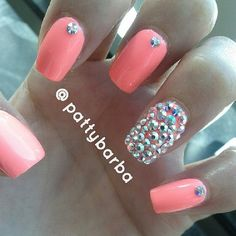coral and bejeweled nails