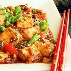 Thai style stir fried tofu with basil. Its hot but not fiery.