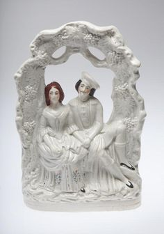 Staffordshire ceramic figurine of a couple seated holding hands. Possibly a wedding scene. (1845-1855) Missouri History Museum. collections.mohistory.org