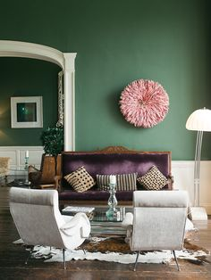I would never think to do green walls (obviously - I love white!) but look at it with the purple couch.  Rich and luxurious!