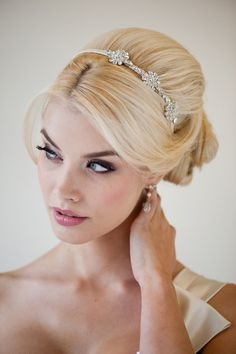 Ribbon wrapped metal headband with Swarovski crystal embellishments. Available in white or ivory.