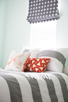 Love the idea of the blinds with a material blackout roman blind over top for naps or summer nights